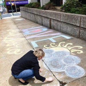 McKenzie Real Estate paints Asheboro with inspirational chalk art